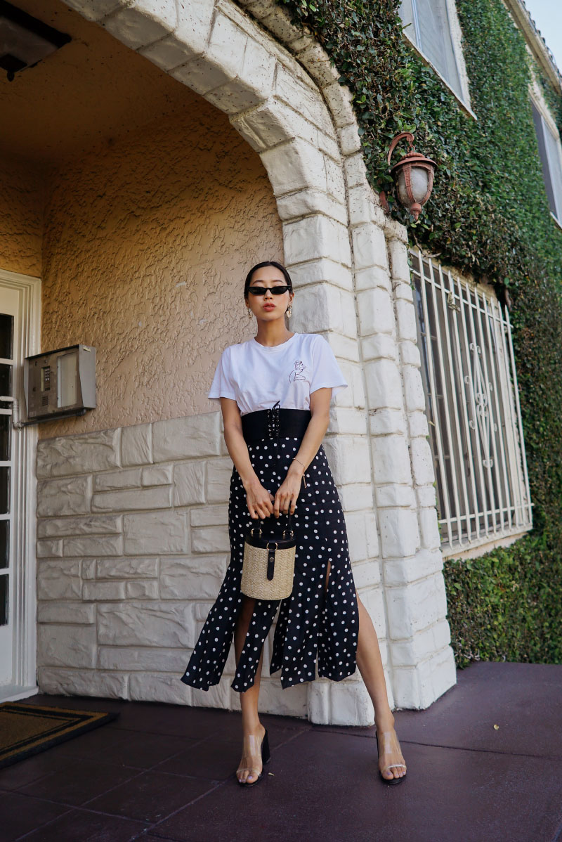 Aimee_song_of_style_two_songs_tits_out_tee_frame_corset_belt_rixo_london_polka_dot_skirt_paola_vilas_abstract_earrings_lpa_woven_handbag_who_what_wear_target_clear_sandals